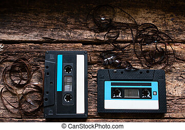 two old Cassette tape on a wooden background