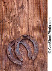 two old cast iron metal western horse shoeing accessory...