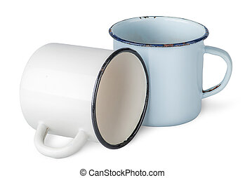 Two old enameled mugs beside