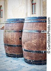 Two old oak barrels brown with metal hoops