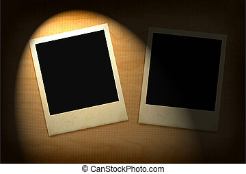 two old photo frames lit in darkness