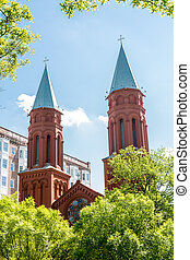 Two Old Red Brick Steeples with Metal Roof