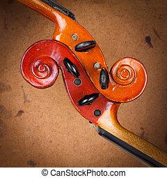 Two old violin scrolls detail over grunge background