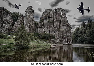Two old warplanes flying over the Externsteine.