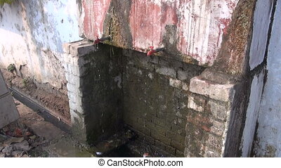 two old water taps on cracked wall