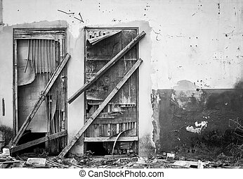 old wooden door of abandoned house , black and white