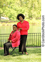 two older black women outdoors at park