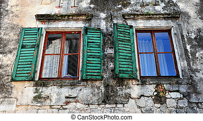 Two open windows with green wooden frames