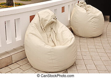 Two Outdoor Leather White Bean Bag Chairs (Beanbag) On The Balcony Or Patio Floor, Close Up