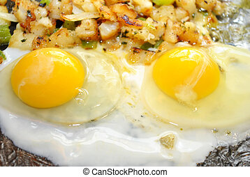 Two Over Easy Eggs Cooking in a Pan