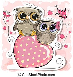 Two Owls is sitting on a heart on a pink background