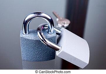 Two padlocks with a key