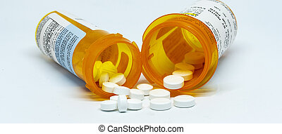 Two pain oill bottles with pills spilling out - Two ...