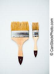Two paintbrushes on white background. Whitewashing brush