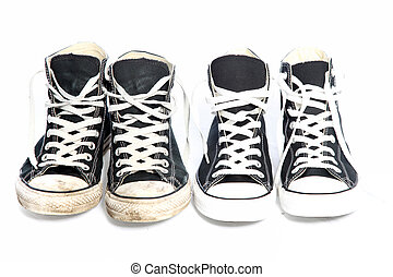 Two pairs of identical lace up blue canvas sneakers - one old with discolouration and dirt and one new