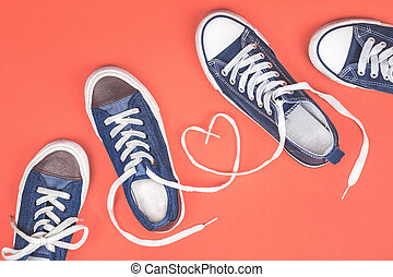 Two pairs of sneakers with laces heart