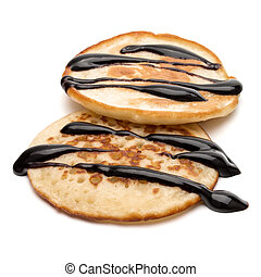 Two pancakes isolated on white background cutout.