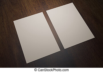 Two paper sheets on wood