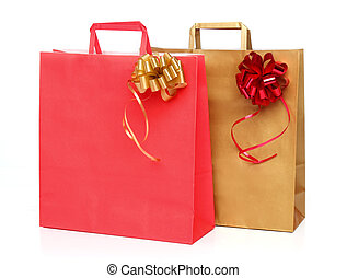 Two paper shopping bags with a ribb