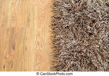 Two part split image of brown shaggy carpet and wooden...