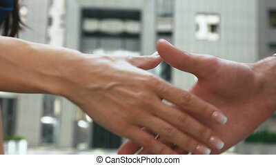 Two partners shaking hands after long working day as a dream...