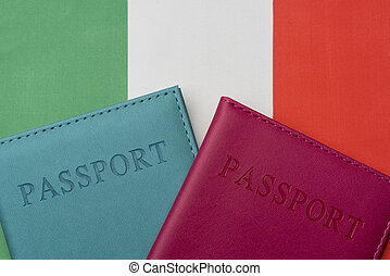 Two passports lie on the flank of Italy. The concept of tourism and travel in Europe.