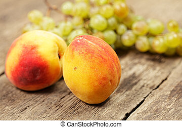 Two peaches and bunch of grapes
