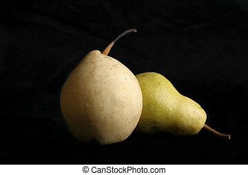 Two Pear - Two different variety of pears on a black ...