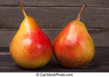 two pears on a dark wooden background