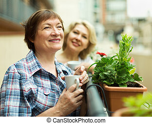 Two pensioner drinking coffee