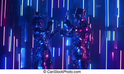 Two people a man and a woman dance in reflective shiny costumes against a neon wall.