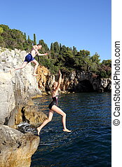 two people are jumping