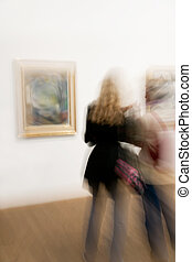Two people at arts exhibition