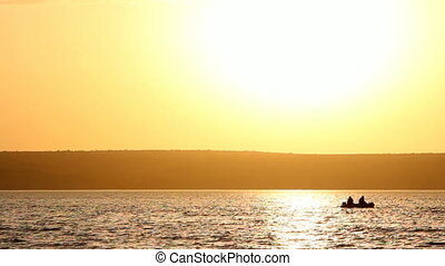 Two people fishing together in a boat - Two mans fishing...