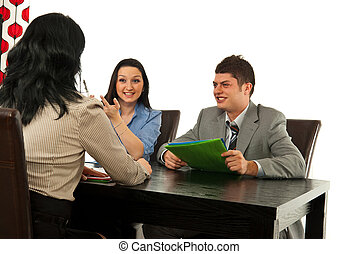 Two people having interview with manager woman in office