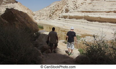 Two people hike in Ein Uvdat - Shot of Two people hike in...