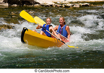 Two people in canoe enjoying holidays and nice weather