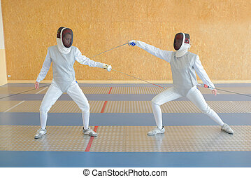 Two people in fencing joust