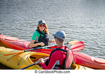 Two people in kayaks on the river