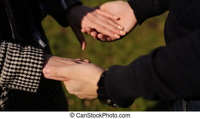 Two people in love holding hands in the park