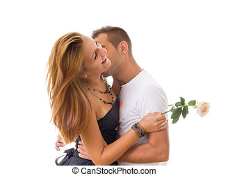 two people in love while man is kissing woman with rose between
