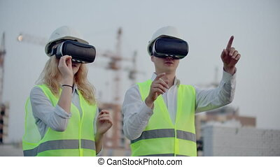 Two people in virtual reality glasses on the background of ...