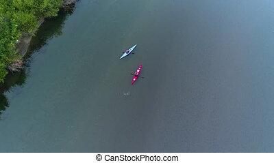 Two People Kayaking on River