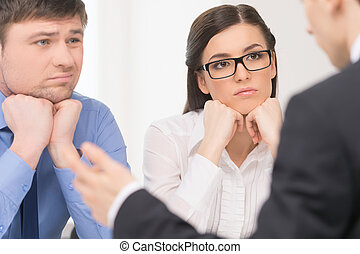 Two people listening to man. Woman with attention and man ...