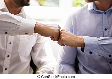 Two People Making Fist Bump