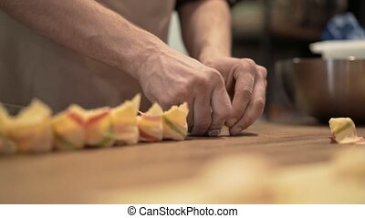 Two people making tortellini, a traditional Italian cuisine...