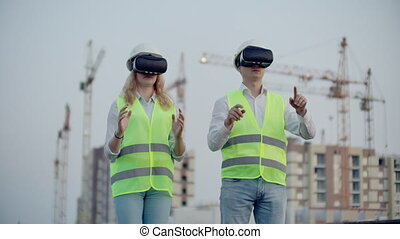 Two people Man and woman wearing virtual reality glasses on ...
