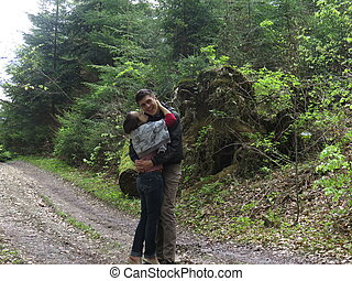 two people on the path in the woods