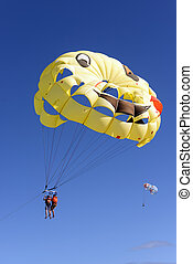two people Parasailing Sky Aerial Adventure