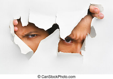 Two people peeking from hole in wall showing their eyes only